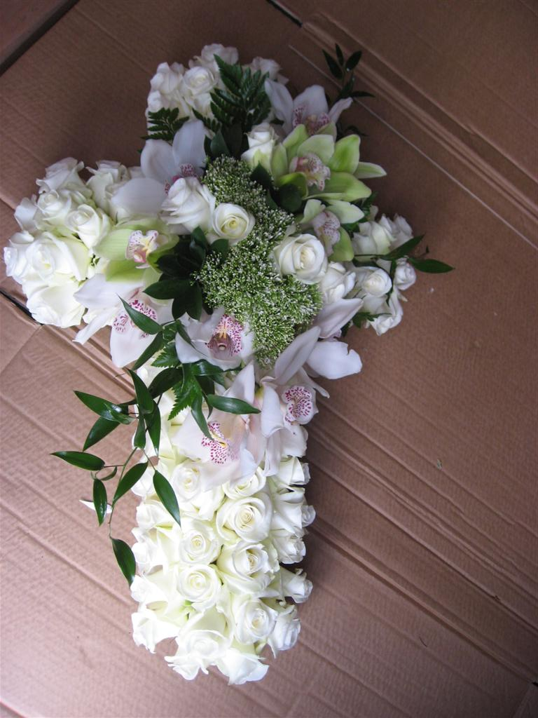 Cross filled with roses & Orchids